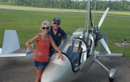 Kathy & pilot/husband Bobby Dabbs beside a gyroplane