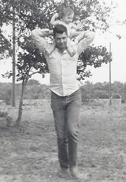 Jimmy holding Joy at the homeplace in Three Rivers, Texas