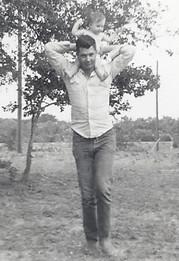 Dad holding his firstborn Joy
