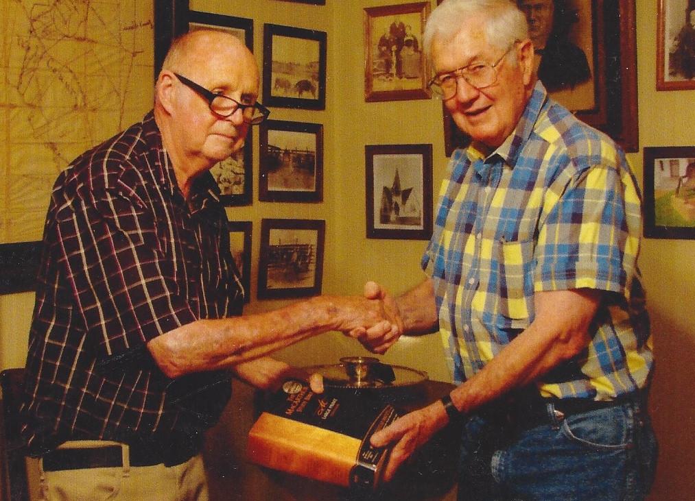 Bill Cotulla presenting a Bible to Jim