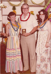 Dad receiving an award from a women's group in Cotulla