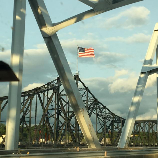 Flag on Mississippi River Bridge