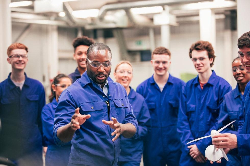 man teaching class in industrial setting