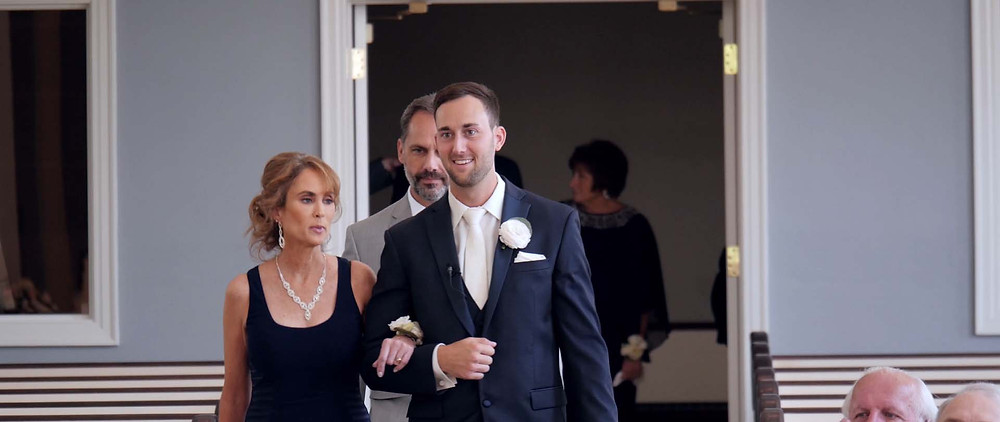 the groom escort his mother down the aisle