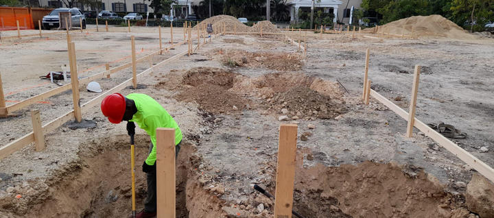 Excavation of 3'x 3' for concrete pilaster filled with concrete and 50% Cayman split rock. . . . #CaymanIslands #RobsonConstruction #WellnessGarden #SevenMileBeach #CaymanContractor #Digging #Excavator #Foundation