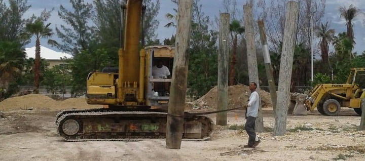 Site Clearing -Uprooting of timber piles . . . #Timber #Piles #TimberPiles #CatExcovator #RobsonConstruction #Construction #CaymanIslands #FoundationPiling