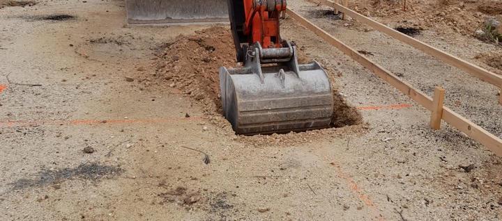 Excavation of 3'x 3' for concrete pilaster filled with concrete and 50% Cayman split rock. . . . #CaymanIslands #RobsonConstruction #WellnessGarden #SevenMileBeach #CaymanContractor #Digging #Excavator #HeavyEquipmentMachine #foundation