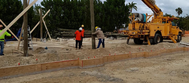 """Our teamwork setting 10"""" timber poles at Wellness Garden Project, taking place in Seven Mile Beach. . . . #RobsonConstruction #CaymanIslands #Timber #TimberPoles #WellnessGarden #SevenMileBeach #PalmHeights #BuildingProcces #Footing #CaymanContractor #WorkSite #ConstructionLife #NewConstruction #ConstructionProject #SettingTimberPoles"""