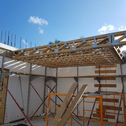 Installing the second floor with pre-engineered web trusses.