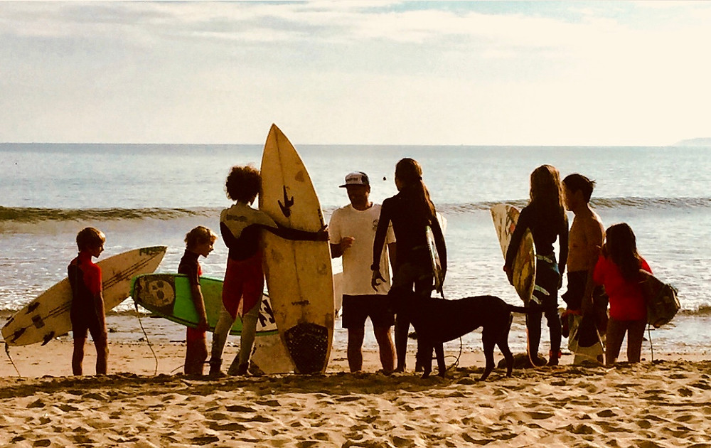 kids listening to their surf teacher