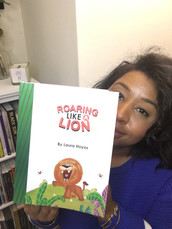 BOOK REVIEW: Roaring Like a Lion by Laura Hoyos