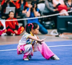 Wushu Competitor in low stance - under 12 years of age