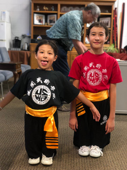 Young Wushu students smiling for the camera