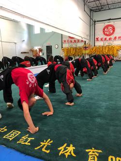 United States Wushu Academy students doing back bends.