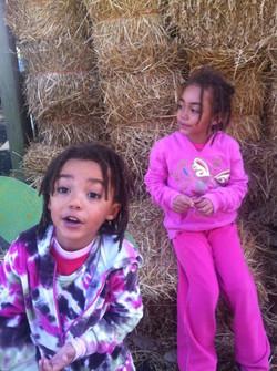 girls on hay bail