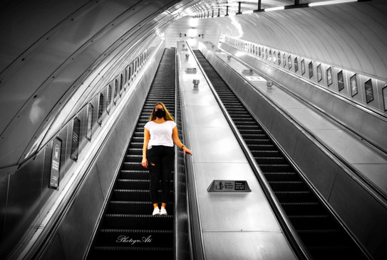 Natalia on the underground station escalator