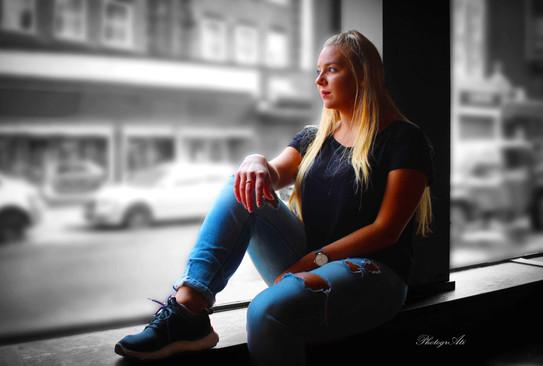 Natalia on the coffee shop's window