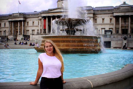 Natalia on the fountain in Trafalgar Square