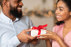 Closeup of happy lovers exchanging gifts on holiday, anniversary, St Valentine's day or bi...man.jpg