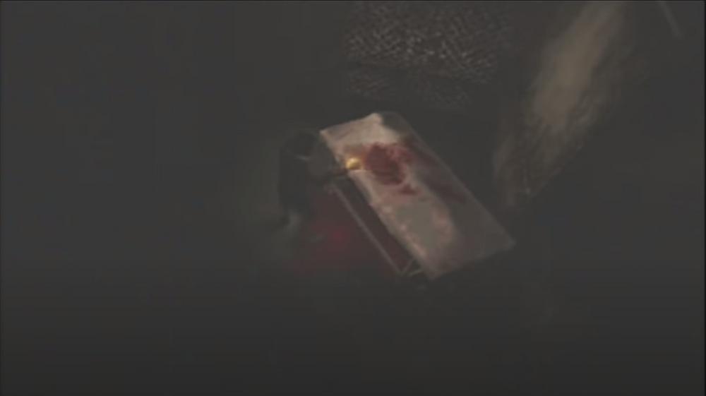 Henry Mason examines a bloody hospital gurney.
