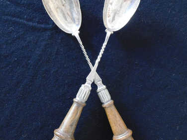 Pair of salad servers with wood handles