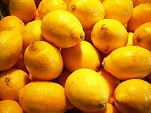 Many lemons illuminated by sun