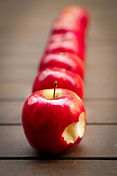 Several red apples aligned