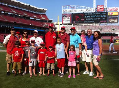 scott on field with kids.jpg