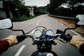 pov-motorcycle-driver-on-empty-road-66SDB2S.jpg