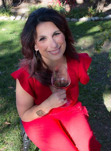 red shirt chair wine lean in 24.jpg
