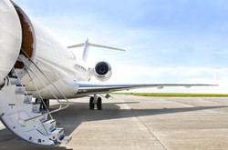 Stairs with Jet Engine on a modern private jet airplane .jpg