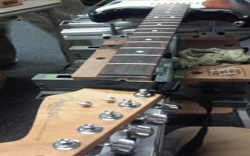 Fender fret level