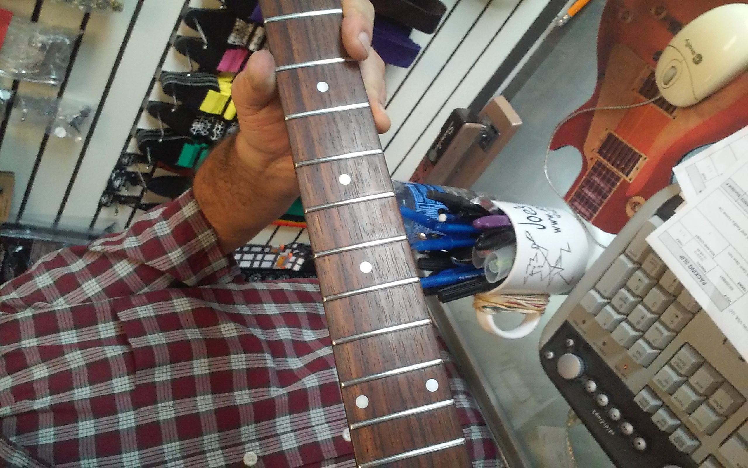 Fret level on guitar neck