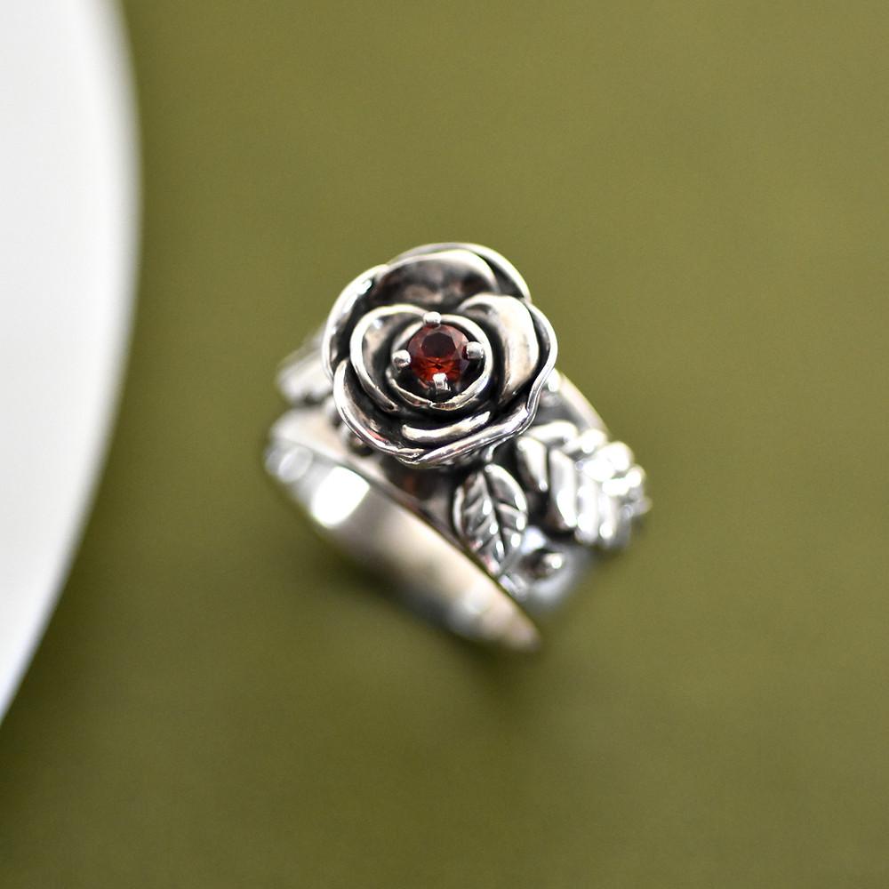 Handmade sterling silver rose ring with garnet by Melissa Pedersen