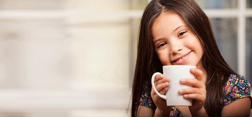 young girl enjoying Ovaltine