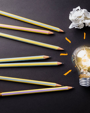 Pencils and glowing light bulb, creative