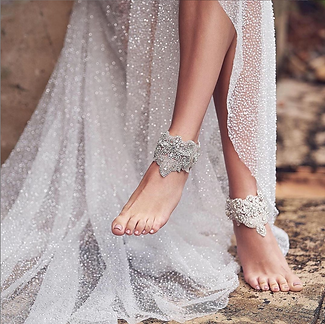 On the beaches of Puerto Rico many brides choose to be comfortable and luxurious with these traveling ankle cuffs