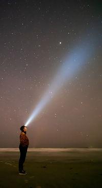 A headlight beam into the starry star night sky Jasper Lior