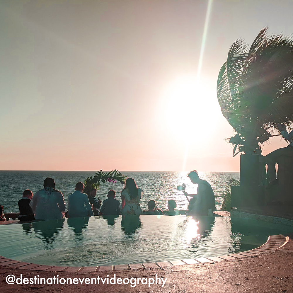 Melissa Smith Shoots Caribbean Destination Wedding at Sunset Queer and female destination wedding videographer shoots private luxurious beachside wedding in cabo rojo puerto rico.
