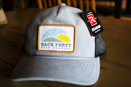 Gray corduroy front with black mesh trucker hat
