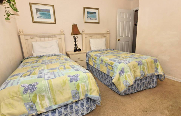 Twin bedroom with TV and DVD player