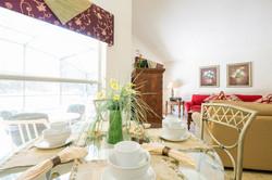 Breakfast table looking onto living area