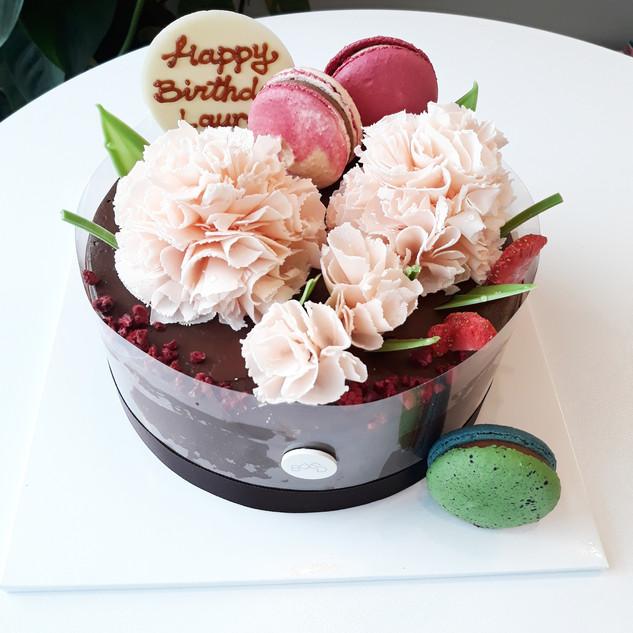 Chocolate Ganache with flowers and macarons