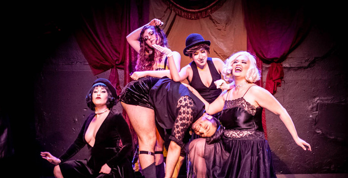 The Devil's during the opening for Effie Dubois' Den of Indecencies
