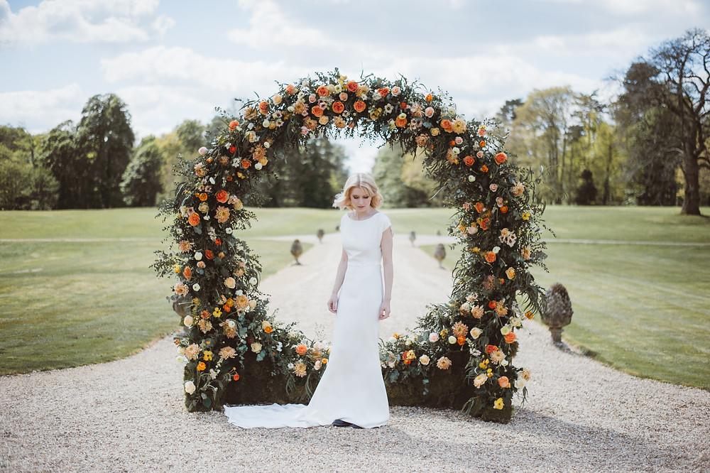 Circular Wedding Ceremony Floral Backdrop