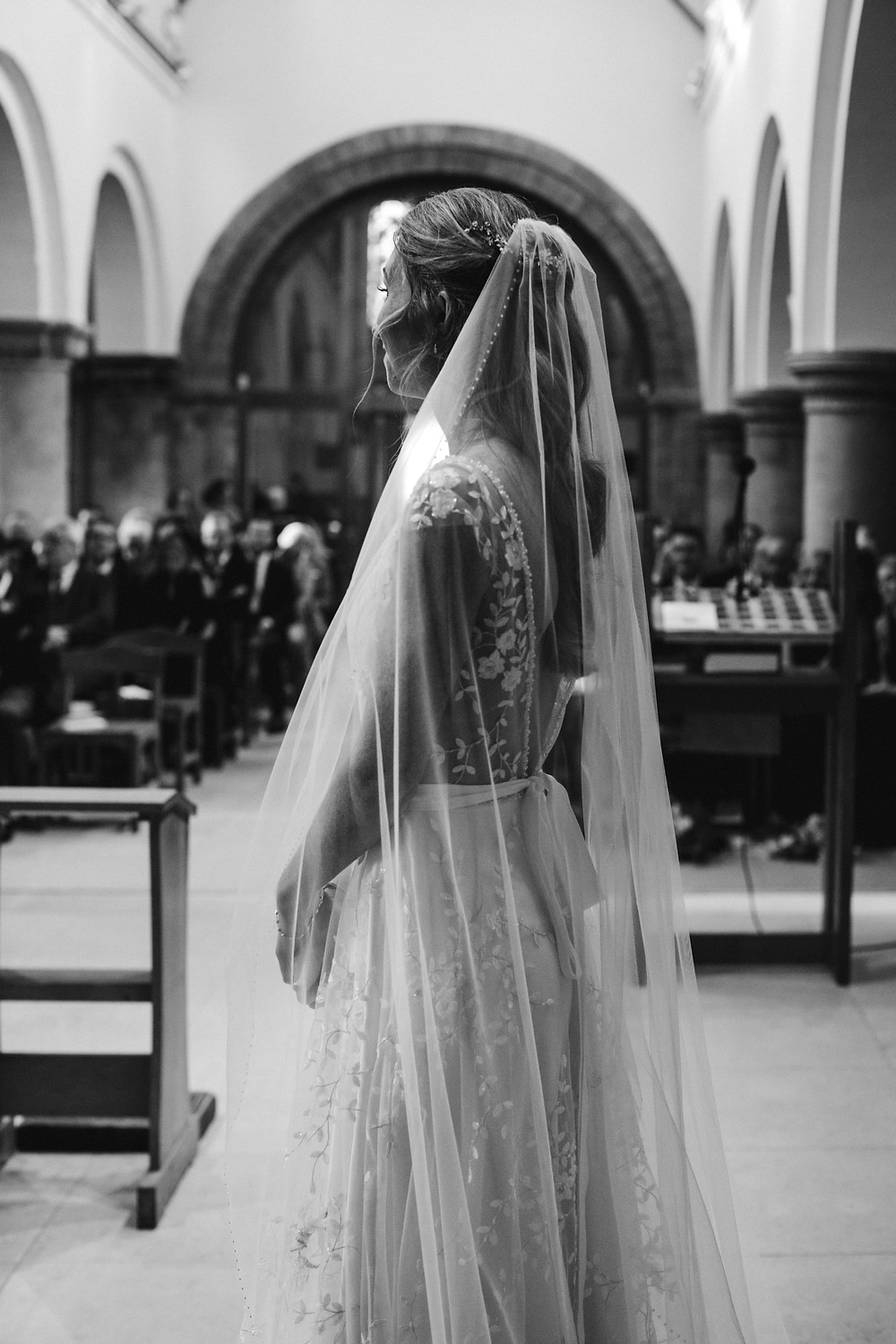 Bride in stunning lace dress and veil