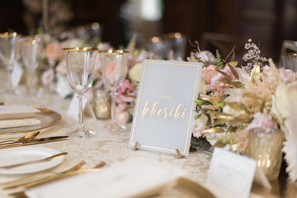 luxury wedding place setting with calligraphy table names
