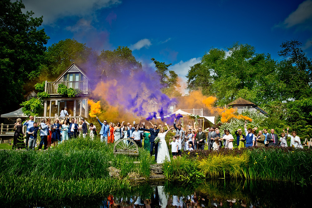 Colorful smoke going off at a Copse wedding