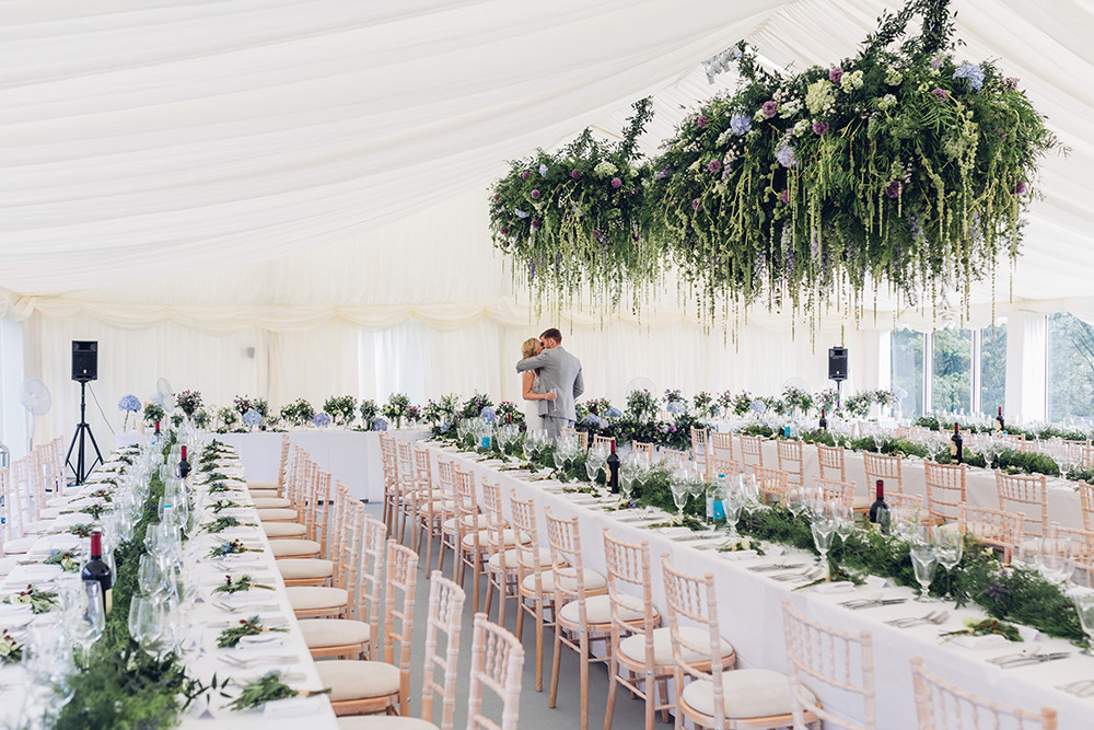 hanging florals in a clearspan marquee