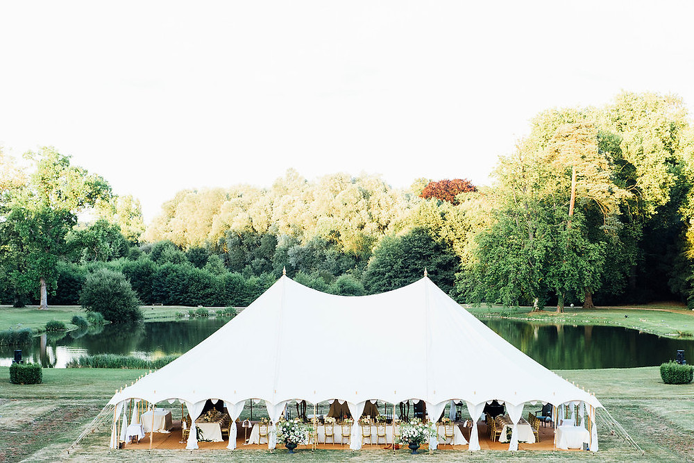 traditional wedding marquee with poles